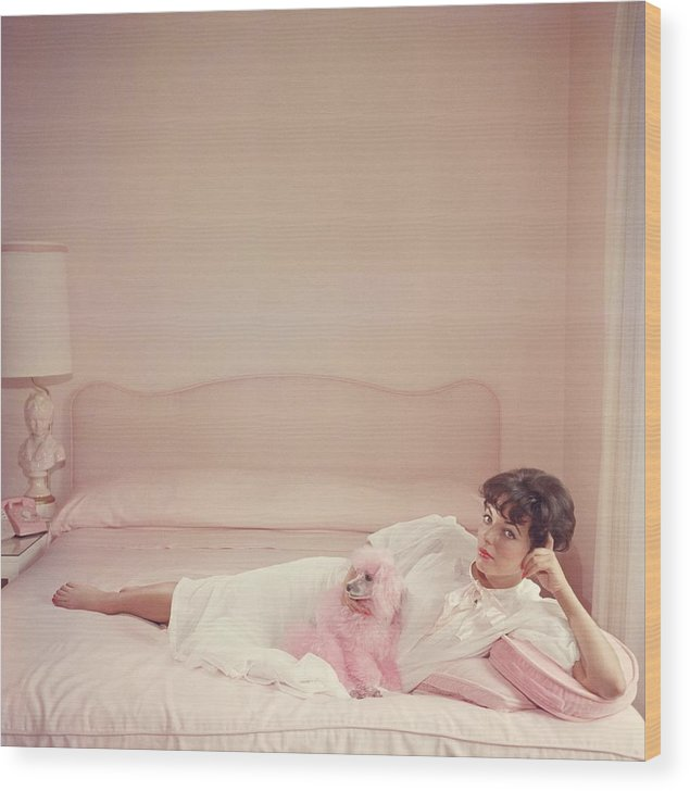 People Wood Print featuring the photograph Joan Collins Relaxes by Slim Aarons