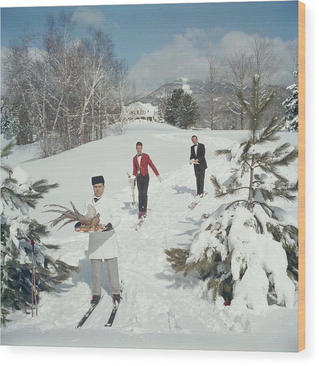 Skiing Wood Print featuring the photograph Skiing Waiters by Slim Aarons