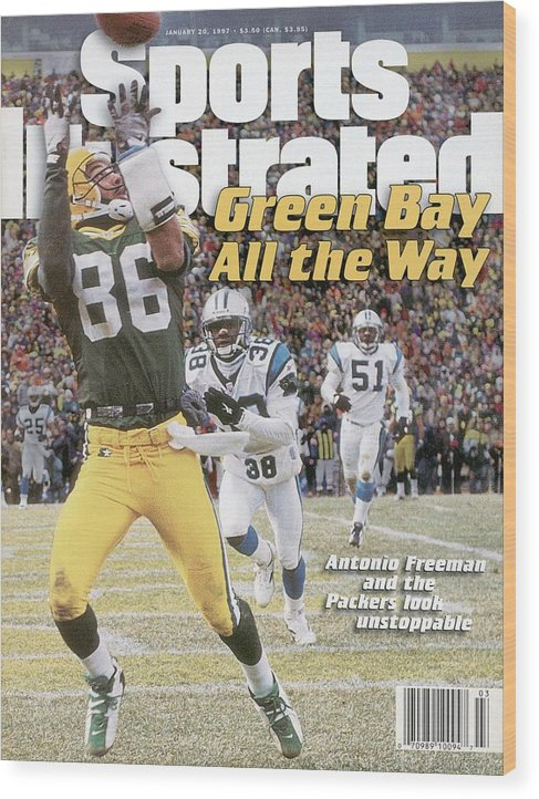 Magazine Cover Wood Print featuring the photograph Green Bay Packers Antonio Freeman, 1997 Nfc Championship Sports Illustrated Cover by Sports Illustrated