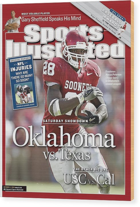 Magazine Cover Wood Print featuring the photograph University Of Oklahoma Adrian Peterson Sports Illustrated Cover by Sports Illustrated