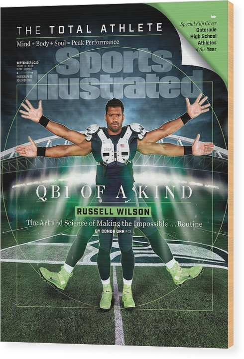 Russell Wilson Wood Print featuring the photograph QB One of a Kind Russell Wilson Sports Illustrated Cover by Sports Illustrated