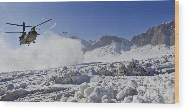 Chinook Wood Print featuring the photograph Snow Flies Up As A U.s. Army Ch-47 by Stocktrek Images