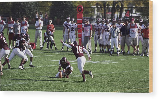 Kicking Wood Print featuring the photograph Football by Wes Shinn