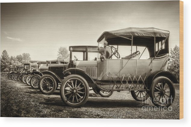 Ford; Model T; Vintage; Antique; Town; Parked; Row; Tires; Cars; Autos; Automobiles; Transportation; Turn Of The Century; Early 1900s; 20s; 1920s; Parking Lot; Vehicle; Light; Sepia Wood Print featuring the photograph Parking by Margie Hurwich