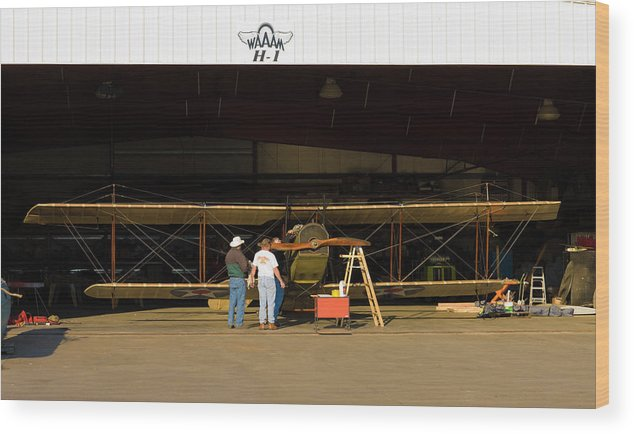 Air Vehicle Wood Print featuring the photograph Pilot Works On Antique Plane In Hood by Richard Hallman