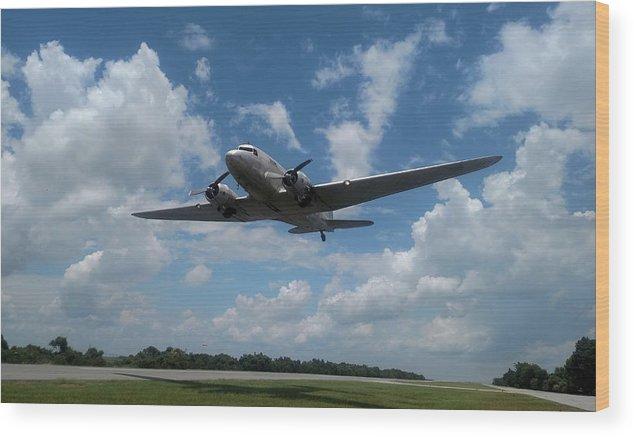 C-47 Dakota Wood Print featuring the photograph C-47 Dakota Low Pass Over Jekyll Island Airport. 2015 by Robert Youmans