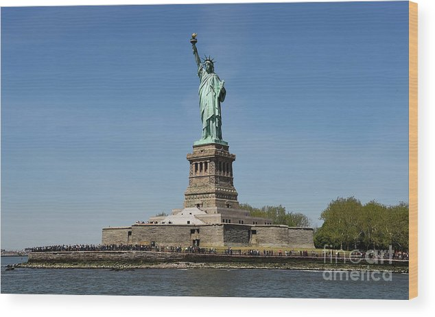Statue Of Liberty Bedloes Island Liberty Island New York City Travel Freedom River People Tourist Landmark Visitors United States By Manhattan French Sculptor Frederic Auguste Barthold Monument State Wood Print featuring the photograph Statue Of Liberty by Howard Koby