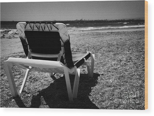 Cyprus Wood Print featuring the photograph Empty Sun Lounger On Cyprus Tourist Organisation Municipal Beach In Larnaca Bay Republic Of Cyprus by Joe Fox
