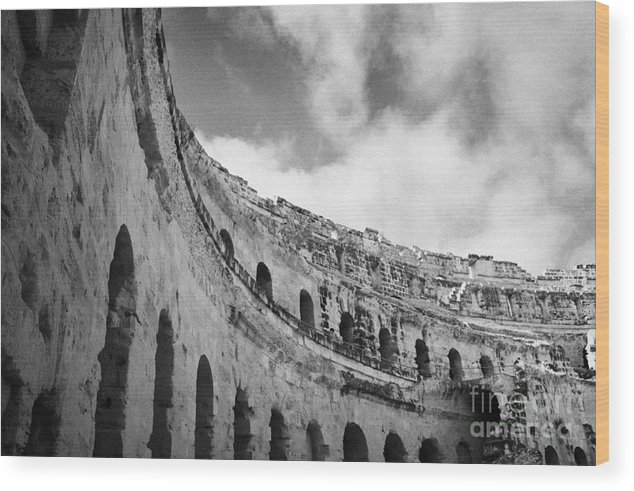 Tunisia Wood Print featuring the photograph Looking Up At Blue Cloudy Sky And Upper Tiers Of The Old Roman Colloseum At El Jem Tunisia by Joe Fox