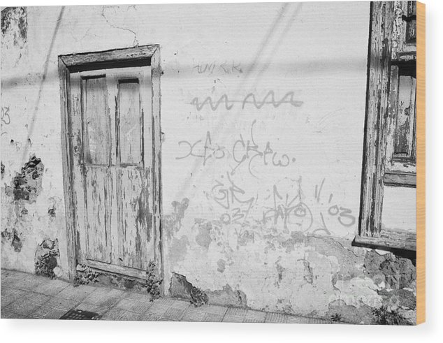 Europe Wood Print featuring the photograph old weathered green painted wooden door entrance to abandoned house with cracked stucco walls and graffitti in Tacoronte Tenerife Canary Islands Spain by Joe Fox