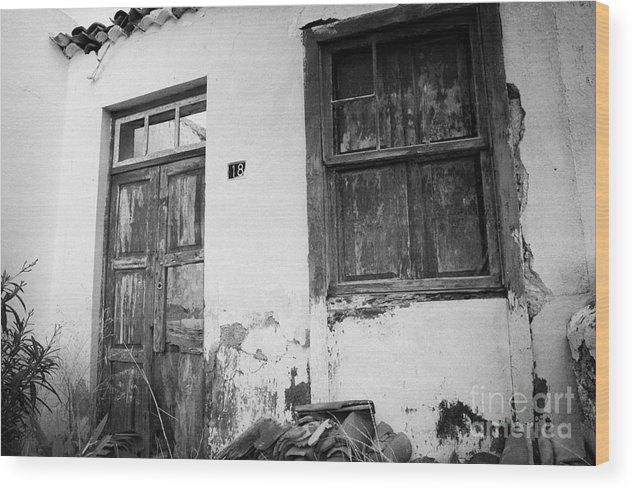 Europe Wood Print featuring the photograph old weathered wooden door entrance to abandoned house 18 with window and cracked stucco walls in Los Banquitos Tenerife Canary Islands Spain by Joe Fox