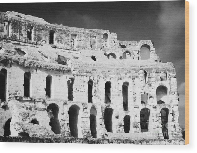Tunisia Wood Print featuring the photograph Remains Of Upper Tiers Looking Up From The Arena Floor Of The Old Roman Colloseum At El Jem Tunisia by Joe Fox