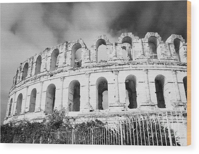 Tunisia Wood Print featuring the photograph The Old Roman Colloseum Against Blue Cloudy Sky El Jem Tunisia by Joe Fox