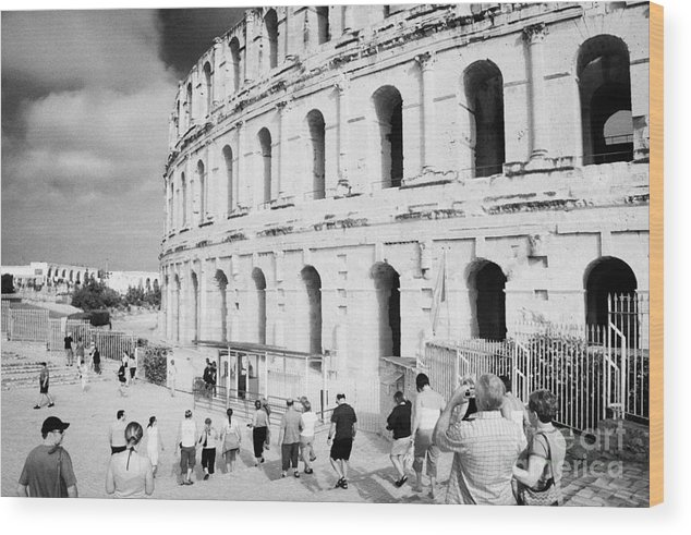 Tunisia Wood Print featuring the photograph Tourists Walk Down Steps Towards The Main Entrance Of The Old Roman Colloseum Against Blue Cloudy Sky El Jem Tunisia by Joe Fox