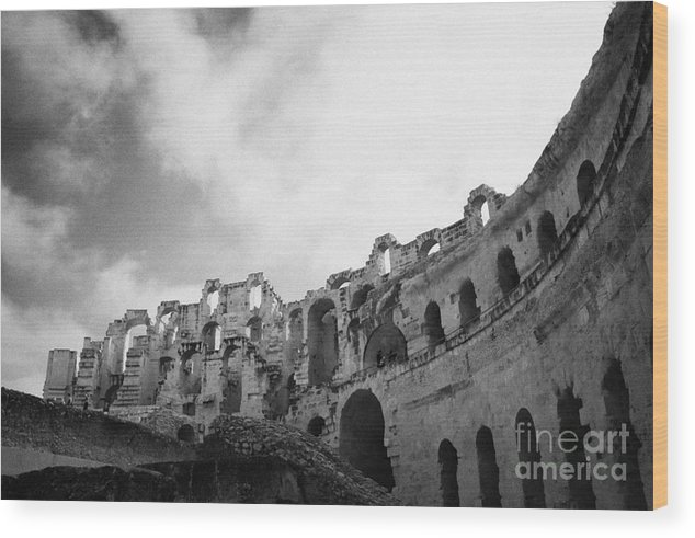 Tunisia Wood Print featuring the photograph Upper Tiers Of The Old Roman Colloseum From The Inside Looking Up At Blue Cloudy Sky At El Jem Tunisia by Joe Fox