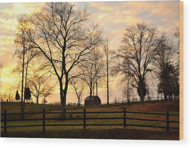 Barn Wood Print featuring the photograph Sunrise Over A Barn by Heather Nicole Williams