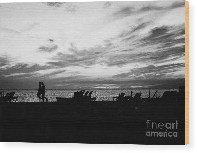 Europe Wood Print featuring the photograph sunset over couple walking along the beach at playa de las americas Tenerife Canary Islands Spain by Joe Fox
