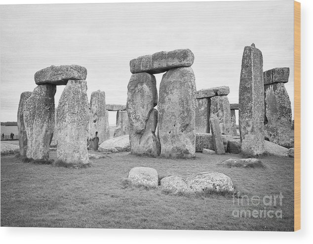 Stonehenge Wood Print featuring the photograph View Of Circle Of Sarsen Trilithon Stones At Side Opposite The Avenue Stonehenge Wiltshire England U by Joe Fox