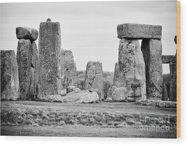 Stonehenge Wood Print featuring the photograph View Of Circle Of Sarsen Trilithon Stones With Tenon Joint On One On Left And Banking With Centre Al by Joe Fox