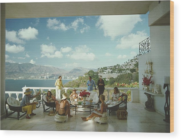 People Wood Print featuring the photograph Guests At Villa Nirvana by Slim Aarons