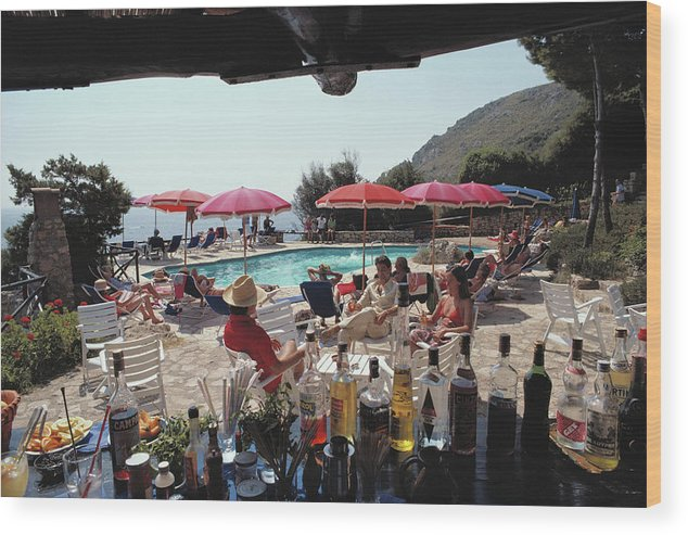 1980-1989 Wood Print featuring the photograph Poolside Bar by Slim Aarons
