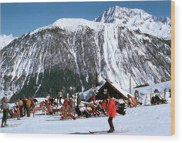 Skiing Wood Print featuring the photograph Skiing At Courcheval by Slim Aarons