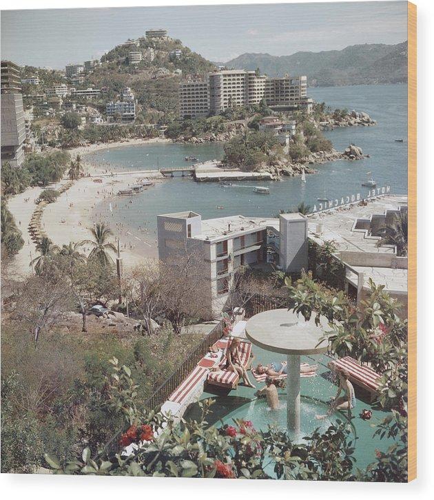 Caleta Beach Wood Print featuring the photograph Caleta Beach, Acapulco by Slim Aarons