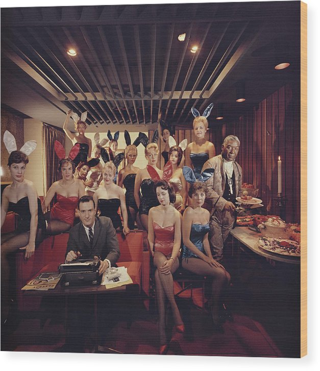 Hugh Hefner Wood Print featuring the photograph Mans Work by Slim Aarons