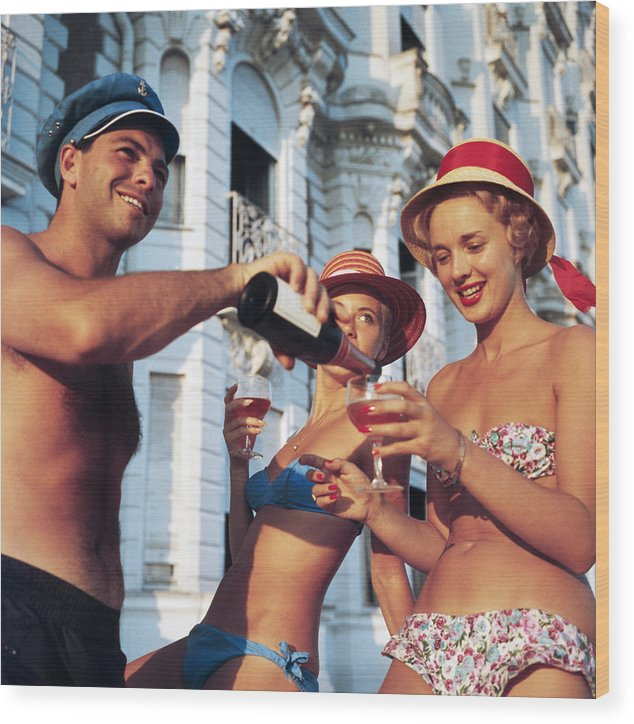 1950-1959 Wood Print featuring the photograph Top Up by Slim Aarons