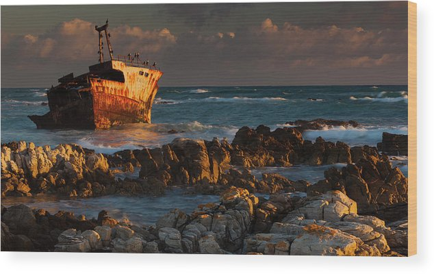 Non-urban Scene Wood Print featuring the photograph A Rusting Wreck, An Abandoned Ship Off by Mint Images - Art Wolfe