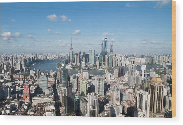 Tranquility Wood Print featuring the photograph Shanghai Skyline Across The Huangpu by Hugociss