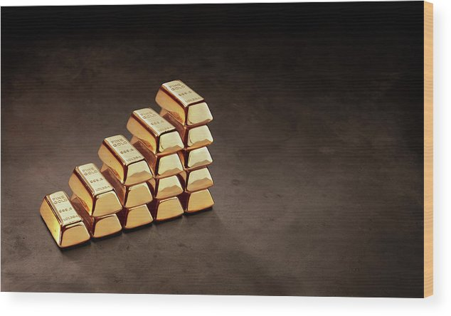 In A Row Wood Print featuring the photograph Stepped Stack Of Gold On Dark Surface by Anthony Bradshaw