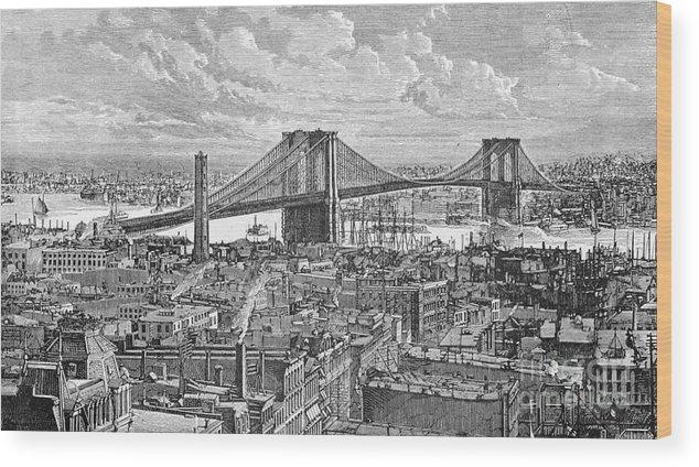 Suspension Bridge Wood Print featuring the photograph View Of The Brooklyn Bridge by Bettmann