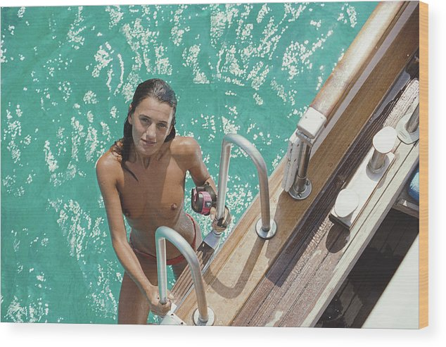1980-1989 Wood Print featuring the photograph Eva Maria Lopez by Slim Aarons