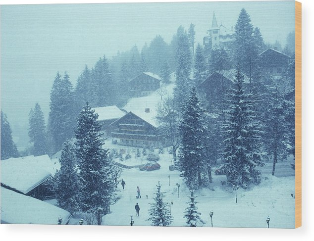 Gstaad Wood Print featuring the photograph Winter In Gstaad by Slim Aarons