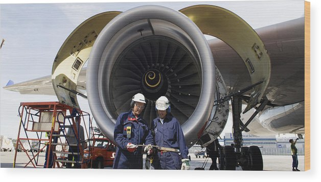 Airplane-mechanics Wood Print featuring the photograph Jet Engine And Air Mechanics by Christian Lagereek