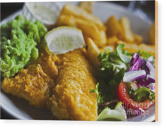 And Chips Deep Evening Fish Food Fried Lemon Meal Mushy Pees Prepared Pub Restaurant Salad Sauce Tarter Wood Print featuring the photograph Fish And Chips by Sanyi Kumar