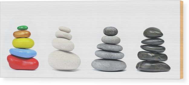 Stability Wood Print featuring the photograph Four Stacks Of Multi-colored To Black Pebbles by Sami Sarkis
