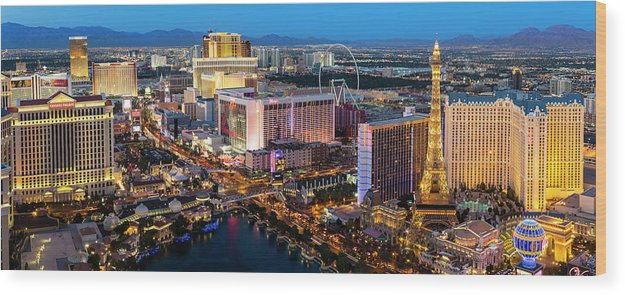 Las Vegas Replica Eiffel Tower Wood Print featuring the photograph Las Vegas Skyline At Dusk by Sylvain Sonnet