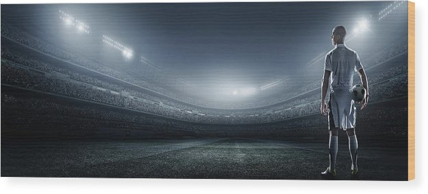 Soccer Uniform Wood Print featuring the photograph Soccer Player With Ball In Stadium by Dmytro Aksonov