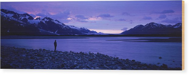 Alsek Wood Print featuring the photograph A Man Standing On The Edge Of A Lake by David McLain