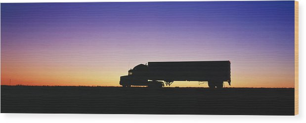 18 Wheeler Wood Print featuring the photograph Truck Parked On Freeway At Sunrise by Jeremy Woodhouse
