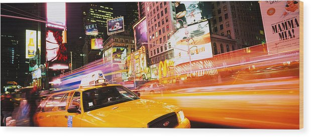 Photography Wood Print featuring the photograph Yellow Taxi On The Road, Times Square by Panoramic Images