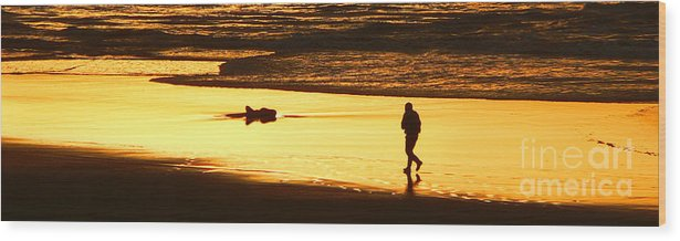 Pacific Ocean Wood Print featuring the photograph Jog At Sunset by Larry Keahey