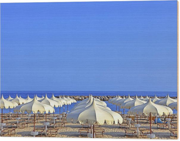 Umbrellas in the sun by Joana Kruse