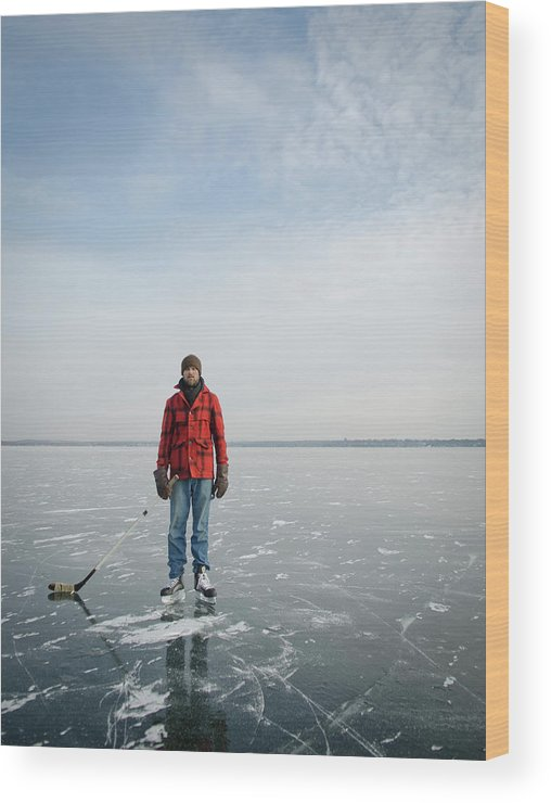 Day Wood Print featuring the photograph An Adult Male Playing Ice Hockey Poses by David Nevala