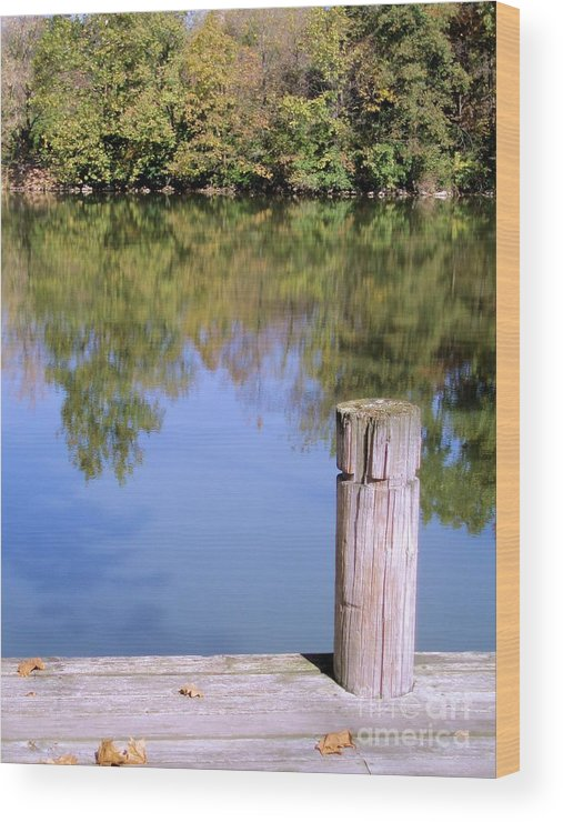 Water Wood Print featuring the photograph On The Dock by Tahlula Arts