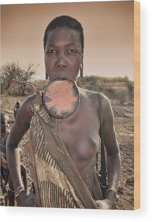 Mursi Woman Displaying Lip Plate In Souther Ethiopia Wood Print featuring the photograph Mursi Woman by Nichon Thorstrom