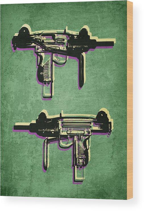 mini uzi sub machine gun on green wood print by michael tompsett