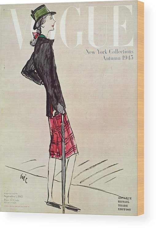 Illustration Wood Print featuring the photograph Vogue Cover Featuring A Woman In A Plaid Skirt by Carl Oscar August Erickson